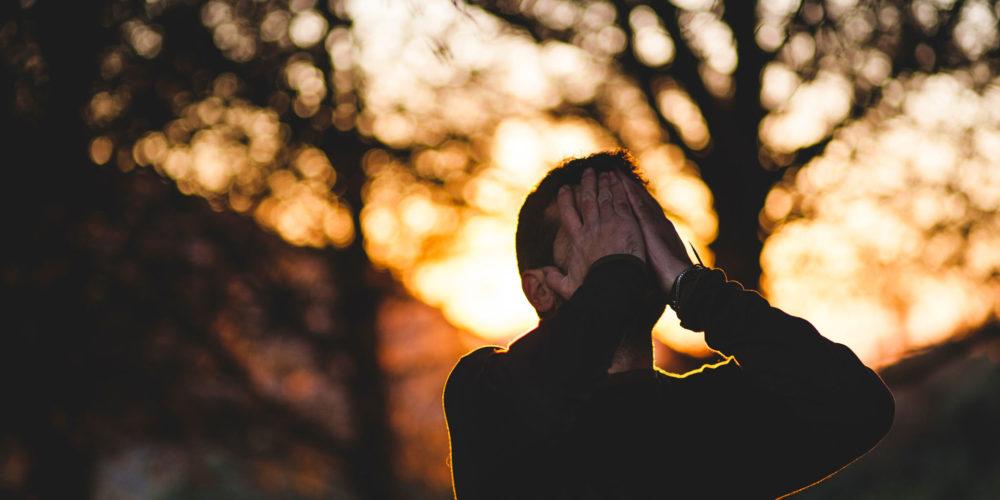 Man Praying Outside